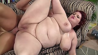 Busty redhead BBW gets fucked by a well hung guy