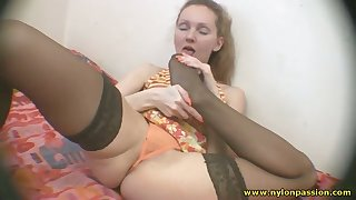 This slattern likes to show off her stockings and her pussy is on full display