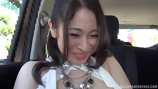Kinky video of busty housewife Minami Ayase flashing in the car